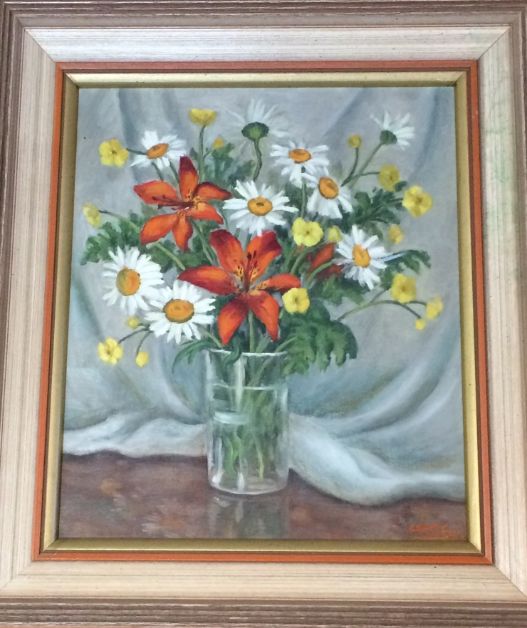 A painting depicting vase of buttercups, daisies, tiger lilies and ferns backdrop by drapery. The painting is signed Kae Heart Ellis.
