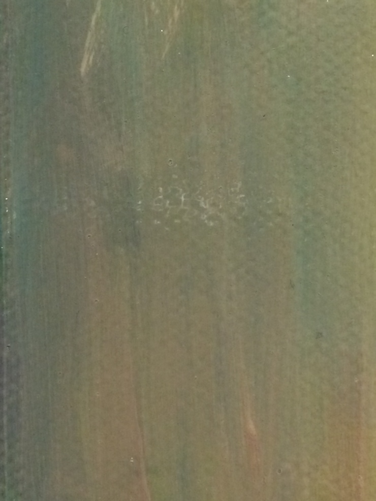 a close up of brush stokes of greenish grey paint.
